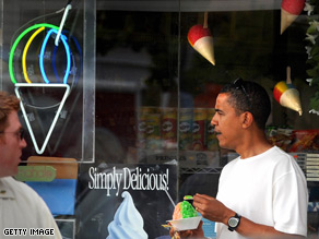 Barack Obama enjoys some shaved ice while vacationing in Hawaii with his family.