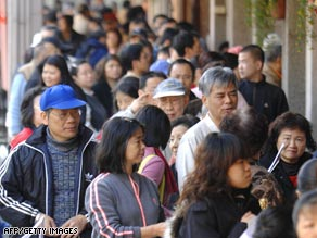 People line up to receive $108 U.S. dollars worth of shopping vouchers in Taipei, Taiwan, last month.