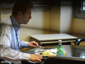 The manager of 3M's French operations, Luc Rousselet, eats while he was held hostage in his office.