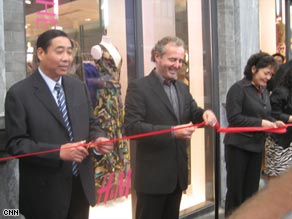 Senior management at H&M in Beijing open the retailer's first store in the Chinese capital.