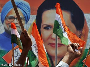 Congress supporters in Banglaore Saturday celebrate the party's lead in election results.