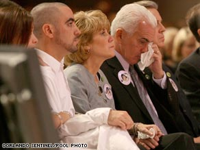 Lee, Cindy and George Anthony occupy a front row pew at a memorial for slain toddler Caylee.