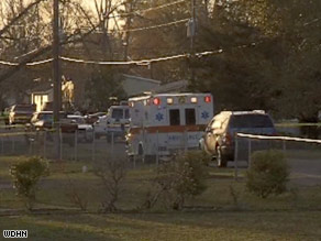 An ambulance rushes to the scene of the multiple shootings in Samson, Alabama, on Tuesday afternoon.