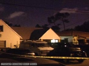 Police tape cordons off a home in Miami, Florida, after police responded early Sunday to reports of shots fired.