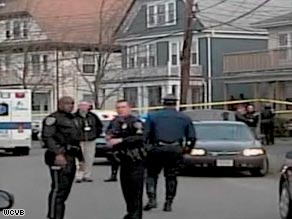 Police outside the Milton, Massachusetts, home where a 23-year-old killed two of his sisters Saturday.