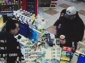 In this surveillance video, a girl can be seen behind the suspect as he draws a gun from his pocket.