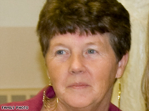Secretary Shirley DeLucia, shot in the stomach, crawled under her desk and dialed 911.
