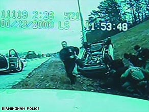 Video shows one black and four white officers beating and kicking unconscious man ejected from car.