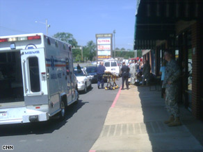 Paramedics transport a soldier on a gurney Monday after an apparent drive-by shooting in Little Rock, Arkansas.