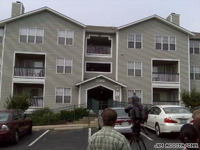 Journalists gather outside the home of Holocaust museum shooting suspect James von Brunn.