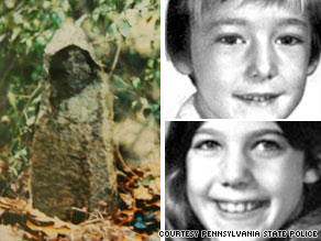 A stone marker in the woods may depict the final resting place of Michael and Karen Reinert.