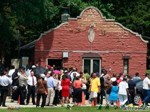 Family members and police gather outside the Burr Oak Cemetery office in Alsip, Illinois, on Wednesday.