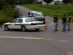 Police gather outside one of the scenes of mutliple slayings in Fayetteville, Tennessee, on Saturday.