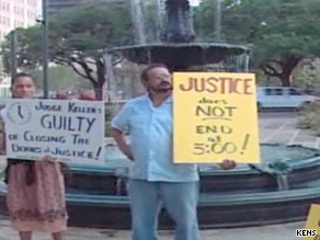 Protesters demonstrate outside the courthouse on Monday.