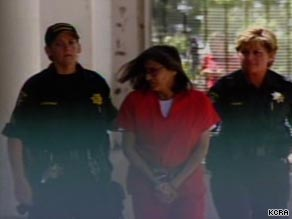 Nancy Garrido is escorted by police in Placerville, California, after her arrest last week.