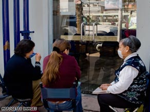 Relatives of flu patients wait outside Mexico's National Institute of Respiratory Diseases.