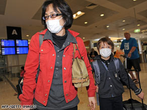 A mother and son wear face masks as protection from swine flu at Sydney international Airport in Australia.