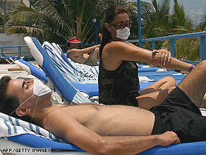 Tourists sunbathe wearing surgical masks in the popular Mexican resort of Acapulco.