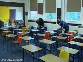 Workers clean a classroom in Fort Worth, Texas, on Thursday as schools were closed because of swine flu.