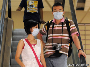 Travelers take precautions against the H1N1 virus in Kuala Lumpur.