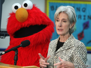 Kathleen Sebelius and Elmo spoke in May at a news conference about the H1N1 flu public service ads.