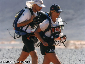 Despite blisters and 130-degree heat, Canadian Sandy McCallum pulls ahead on a grueling day in the desert.