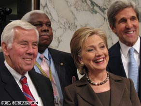 Sen. Hillary Clinton poses for pictures with Sens. John Kerry, right, and Dick Lugar, left.