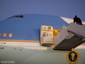 President Barack Obama walks onto Air Force One for his first flight as commander in chief last week.