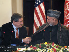 Afghanistan President Hamid Karzai, right, meets with Richard Holbrooke in Kabul on February 15, 2009.