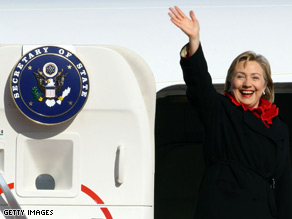 U.S. Secretary of State Hillary Clinton waves upon her departure from Tokyo International Airport on Wednesday.