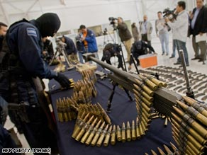 Mexican federal police officers this week display an arsenal seized near the U.S. border.