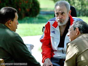 Fidel Castro appears with Venezuela's Hugo Chavez, left, and brother Raúl Castro in a photo released in June.