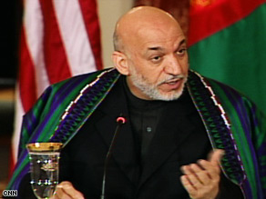 Afghan President Hamid Karzai, in Washington Wednesday, pledged to work with the United States to stabilize his country.