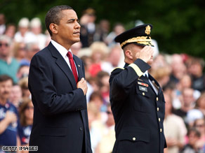 President Obama pays tribute to veterans at a wreath-laying at Arlington National Cemetery on Monday.
