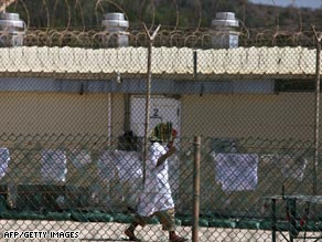 A detainee walks inside an open-air yard at the U.S. prison at Guantanamo Bay, Cuba, on May 31, 2009.