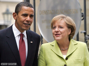 President Obama talks with German Chancellor Angela Merkel in Dresden, Germany, on Friday.