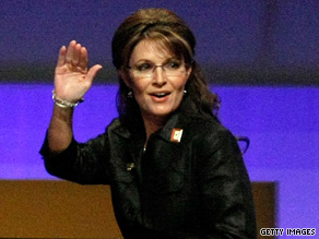 Alaska Gov. Sarah Palin waves to the crowd at the Republican fundraising dinner Monday in Washington.
