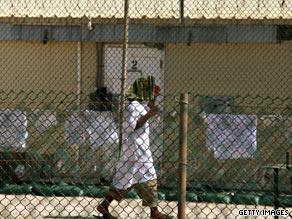 A detainee walks at Camp 4 detention facility at Guantanamo Bay, Cuba, in May.