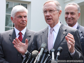 Sen. Harry Reid, center, talks about health care flanked by Sens. Christopher Dodd, left, and Max Baucus Tuesday.