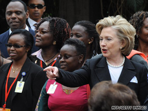 Hillary Clinton stands with survivors of the 1998 bombings of the U.S. Embassy in Nairobi in a ceremony Thursday.