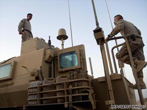 U.S. Marines prepare equipment in Helmand Province, Afghanistan, last month.