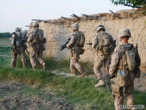 U.S. soldiers patrol an area of Afghanistan in July. The U.S. now has about 62,000 troops in the country