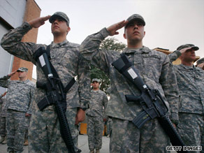 U.S. troops participate in a ceremony commemorating the eighth anniversary of 9/11 in Bagram, Afghanistan.