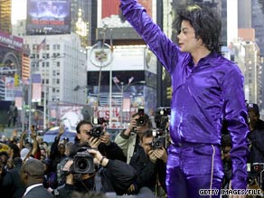 Michael Jackson waves to a crowd of fans and photographers in New York's Times Square.