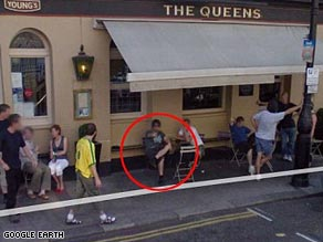 Liam Gallagher says the figure captured on Google Earth outside a pub in London is not him.