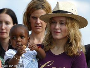 Madonna, pictured with her adopted Malawian son David Banda.