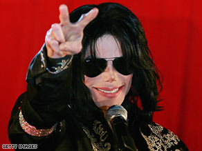 Michael Jackson gestures to the crowd at the March announcement of his series of London concerts.