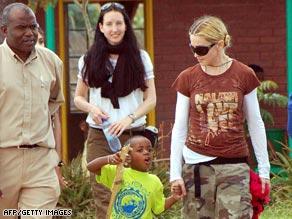 Madonna walks with her Malawian son, David Banda, in Lilongwe, Malawi, in March.
