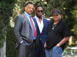 Rev. Jesse Jackson (left) and Joseph Jackson (right) stand outside Michael Jackson's home.