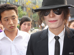 An eerily similar Michael Jackson impersonator performs for devotees in China Tuesday.